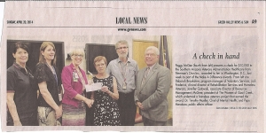 Peggy McGee presents check to VA (Tucson)