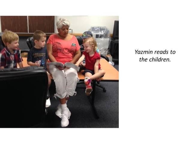 Yazmin reads to the children