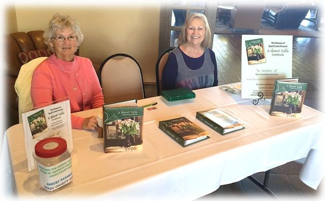Rena Craine and Noreen Melchert sell cookbooks prior to the February meeting.