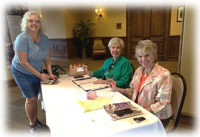 Nancy Wilson and Joyce Walton distribute brunch tickets at the Madera on Thursday, October 15. There to pick up her ticket is member, Lois Bush.