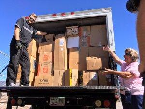 Laura Colbert opens the truck full of VA donations.