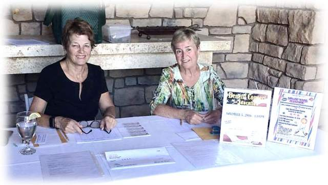 Pat Neel and Marilyn Burkstrand sell concert and basketball tickets on October 9.